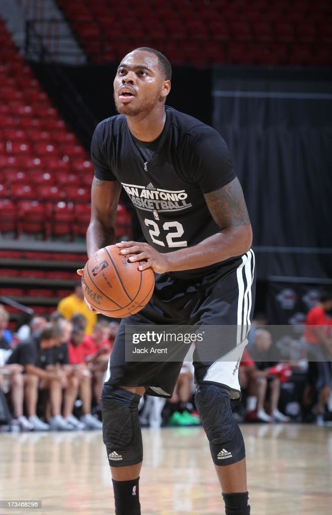 Deshaun Thomas of the San Antonio Spurs handles the ball during NBA Summer League game between the Toronto Raptors and the San Antonio Spurs on July...