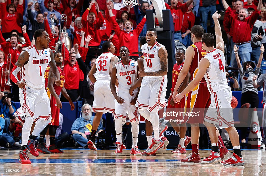 Deshaun Thomas #1, Shannon Scott #3 and LaQuinton Ross #10 of the Ohio State Buckeyes celebrate after Aaron Craft #4 makes a three point basket late in the second half to take the lead against the Iowa State Cyclones during the third round of the 2013 NCAA Men's Basketball Tournament at UD Arena on March 24, 2013 in Dayton, Ohio.