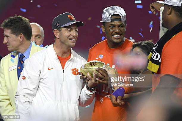 Deshaun Watson and Clemson Tigers head coach Dabo Swinney celebrate with the Fiesta Bowl trophy after the Clemson Tigers beat the Ohio State Buckeyes...