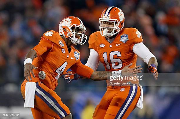Deshaun Watson and teammate Jordan Leggett of the Clemson Tigers react after Watson threw a touchdown in the first half against the North Carolina...