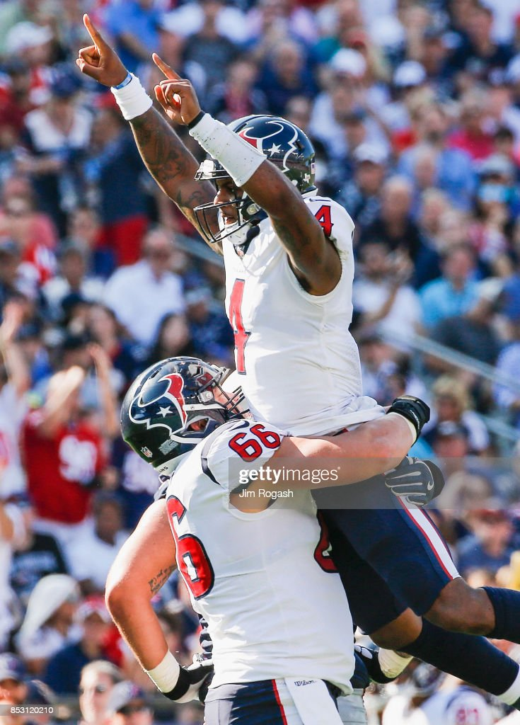 DeShaun Watson #4 celebrates with Nick Martin #66 of the Houston Texans after a touchdown during the third quarter of a game against the New England Patriots at Gillette Stadium on September 24, 2017 in Foxboro, Massachusetts.