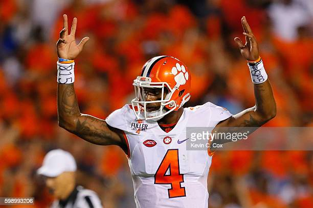 Deshaun Watson of the Clemson Tigers celebrates a rushing touchdown by Wayne Gallman during the second quarter against the Auburn Tigers at Jordan...