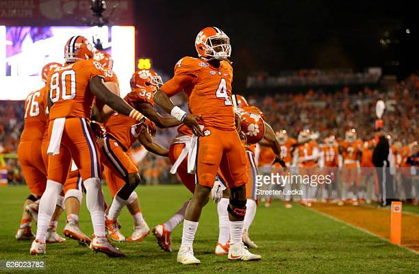 Deshaun Watson of the Clemson Tigers celebrates after a touchdown pass against the South Carolina Gamecocks during their game at Memorial Stadium on...