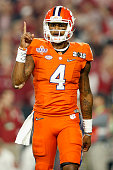 Deshaun Watson of the Clemson Tigers celebrates after throwing an 11 yard touchdown pass to Hunter Renfrow in the first quarter against the Alabama...