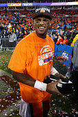 Deshaun Watson of the Clemson Tigers celebrates as he holds the most valuable player trophy after defeating the North Carolina Tar Heels 4537 at the...
