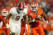 Deshaun Watson of the Clemson Tigers runs the ball in the third quarter against Da'Shawn Hand of the Alabama Crimson Tide during the 2016 College...