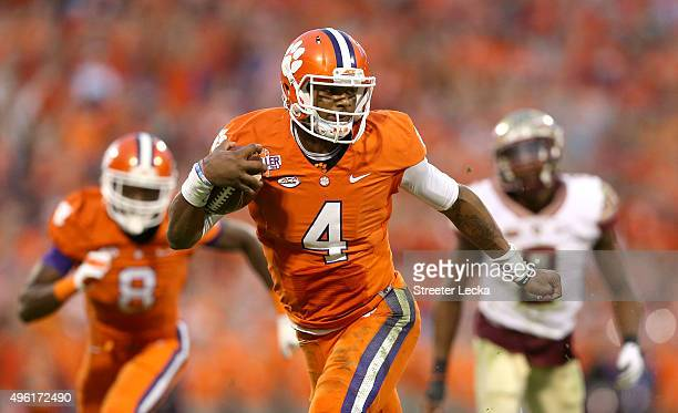 Deshaun Watson of the Clemson Tigers runs with the ball against the Florida State Seminoles during their game at Memorial Stadium on November 7 2015...