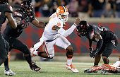 Deshaun Watson of the Clemson Tigers runs with the ball during the game against the Louisville Cardinals at Papa John's Cardinal Stadium on September...