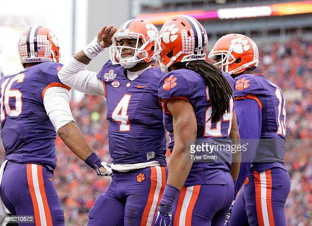 Deshaun Watson of the Clemson Tigers salutes fans after scoring a touchdown during their game against the Wake Forest Demon Deacons at Memorial...