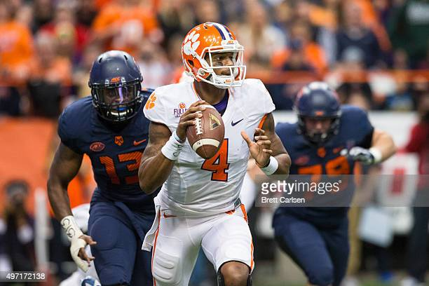 Deshaun Watson of the Clemson Tigers scrambles as Syracuse Orange defenders pursue on November 14 2015 at The Carrier Dome in Syracuse New York...