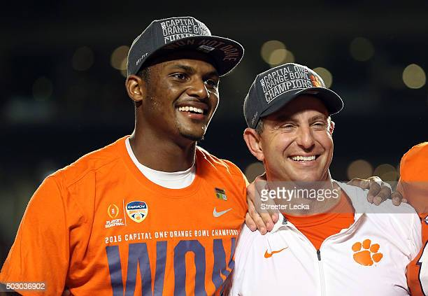 Deshaun Watson of the Clemson Tigers stands with head coach Dabo Swinney after the Clemson Tigers defeated the Oklahoma Sooners with a score of 37 to...