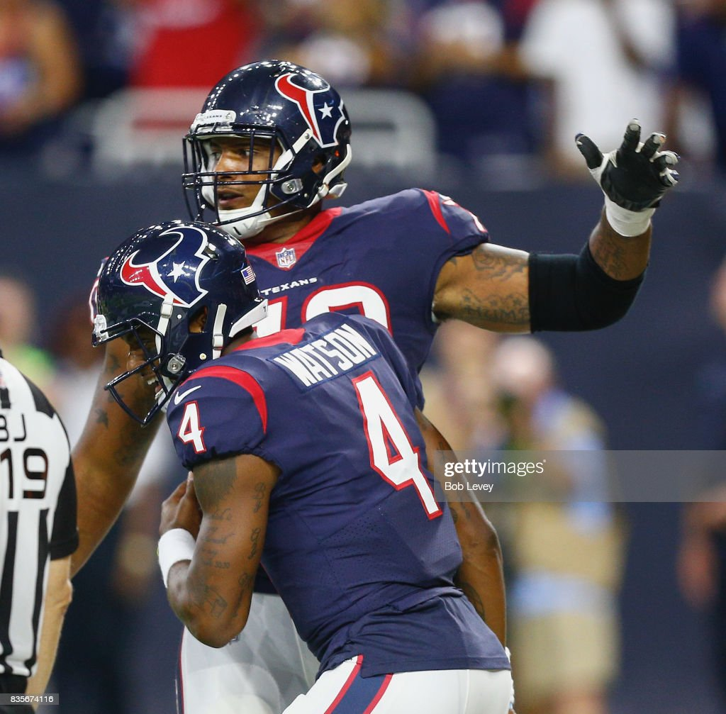 Deshaun Watson #4 of the Houston Texans is congratulated by Julién Davenport #70 after scoring on a two yard run against the New England Patriots at NRG Stadium on August 19, 2017 in Houston, Texas.