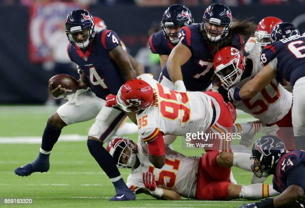 Deshaun Watson of the Houston Texans is sacked by Frank Zombo of the Kansas City Chiefs and Chris Jones in the second quarter at NRG Stadium on...
