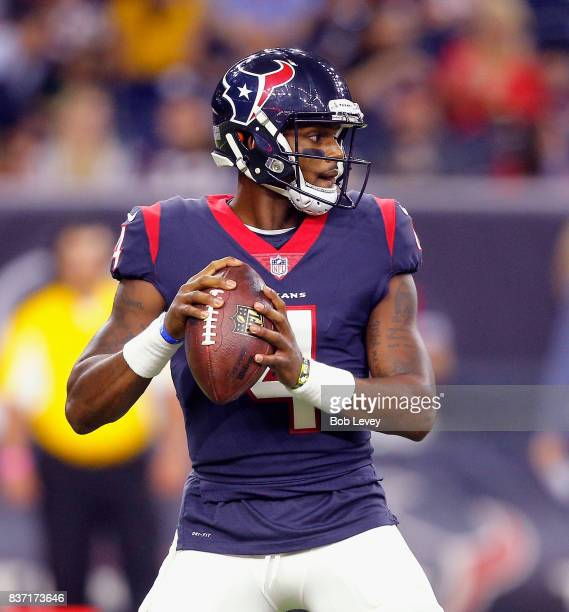Deshaun Watson of the Houston Texans looks for a receiver against the New England Patriots in a preseason game at NRG Stadium on August 19 2017 in...