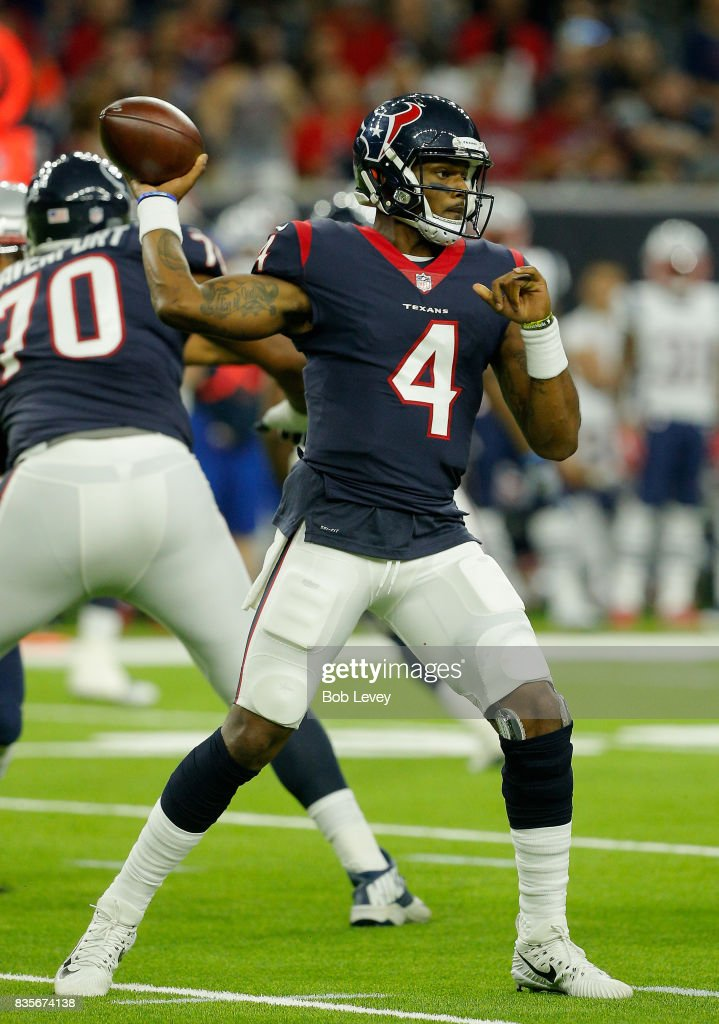 Deshaun Watson #4 of the Houston Texans looks for a receiver in the first half against the New England Patriots at NRG Stadium on August 19, 2017 in Houston, Texas.