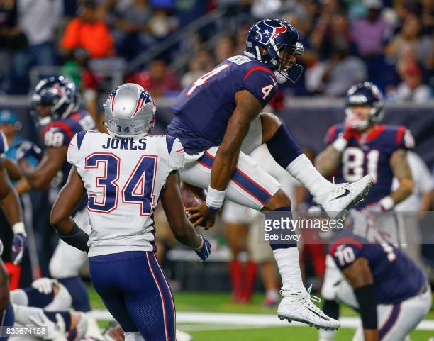 Deshaun Watson of the Houston Texans rushes two yards for a touchdown past David Jones of the New England Patriots in the third quarter at NRG...