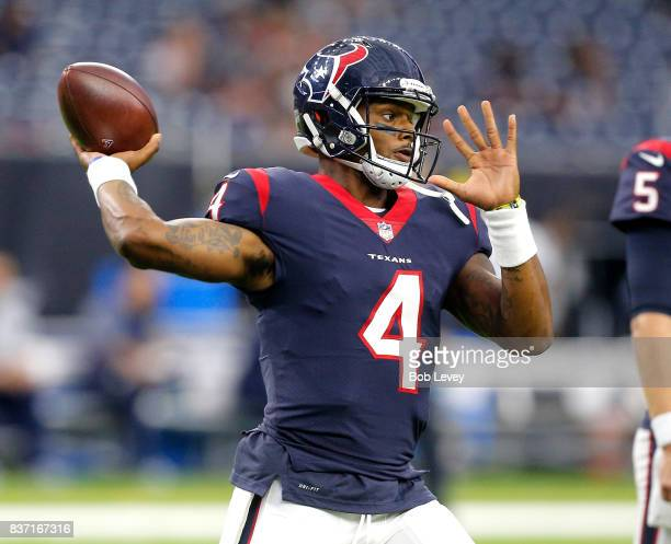 Deshaun Watson of the Houston Texans throws a pass as he warms up to play the New England Patriots in a preseason game at NRG Stadium on August 19...