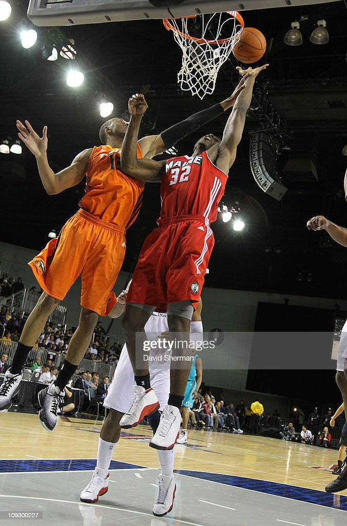 DeShawn Sims #32 of the East All-Stars shoots against Shane Edwards #13 of the West All-Stars during the 2011 NBA D-League All-Star Game presented by SonoSite on center court at Jam Session presented by Adidas during NBA All Star Weekend at the Los Angeles Convention Center on February 19, 2011 in Los Angeles, California.