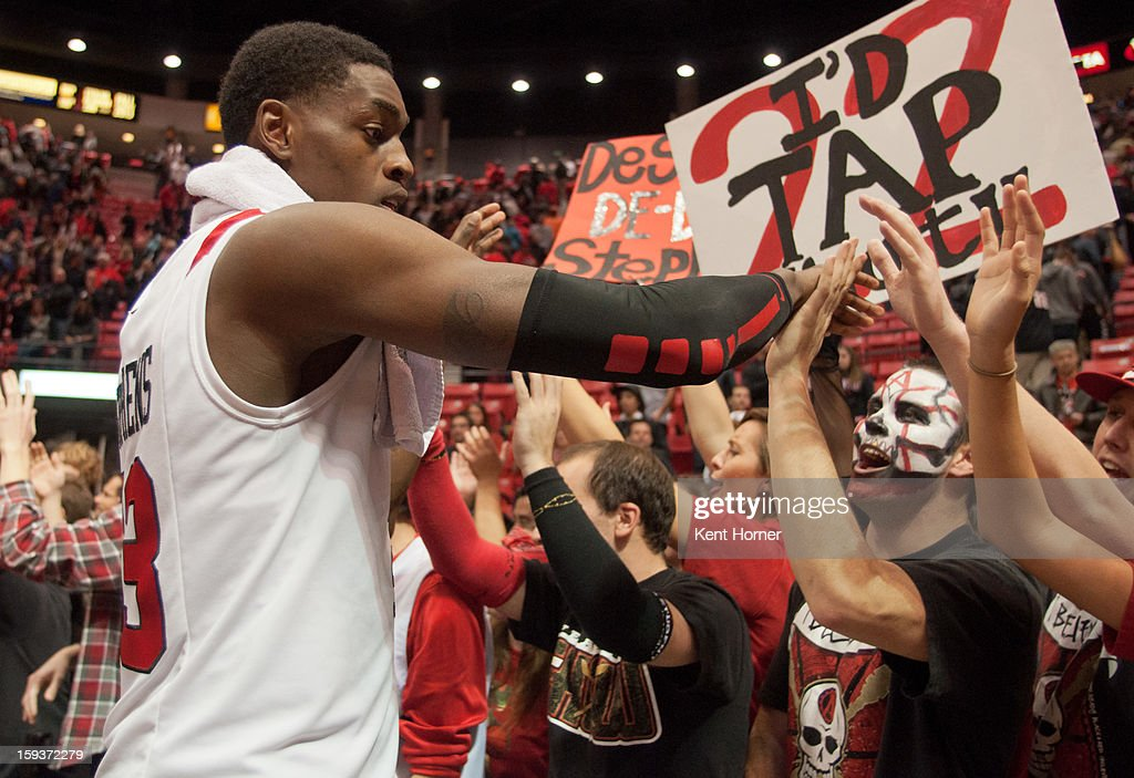 Deshawn Stephens #23 of the San Diego State Aztecs celebrates with fans after winning the game against the Colorado State Rams at Viejas Arena on January 12, 2013 in San Diego, California.