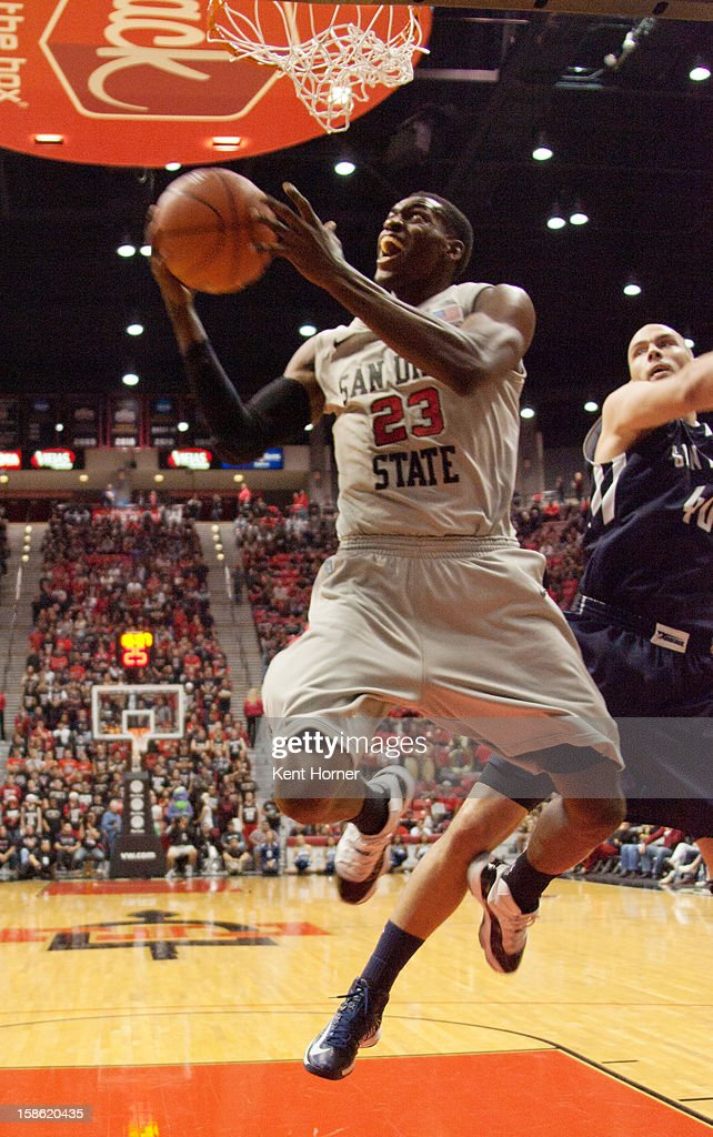 Deshawn Stephens #23 of the San Diego State Aztecs shoots the ball from under the basket in the second half of the game against the University of San Diego Toreros at Viejas Arena on December 15, 2012 in San Diego, California.