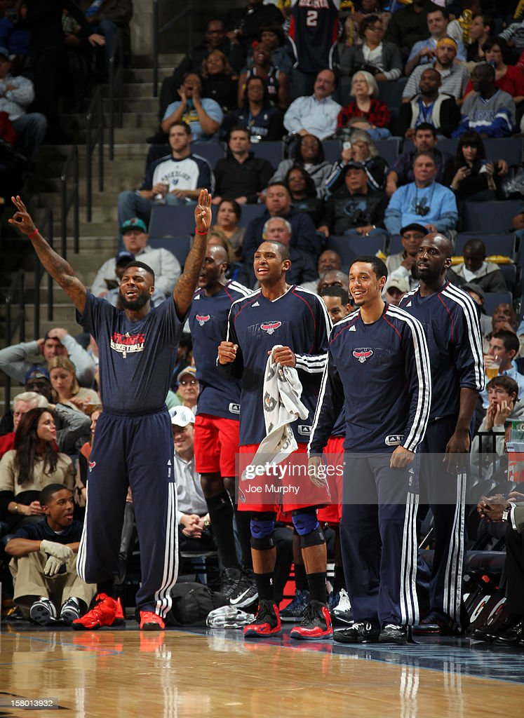 DeShawn Stevenson #92, Al Horford #15, and John Jenkins #12, and Johan Petro #10 of the Atlanta Hawks celebrate on the bench during a game against the Memphis Grizzlies on December 8, 2012 at FedExForum in Memphis, Tennessee.