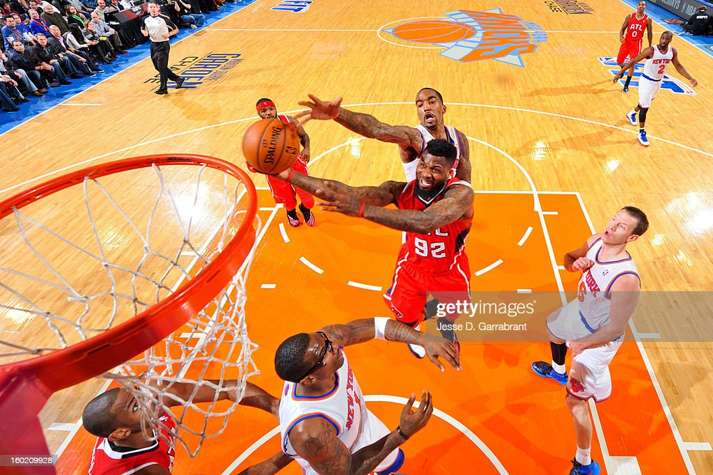 DeShawn Stevenson #92 of the Atlanta Hawks drives to the basket against J.R. Smith #8 of the New York Knicks at Madison Square Garden on January 27, 2013 in New York, New York.