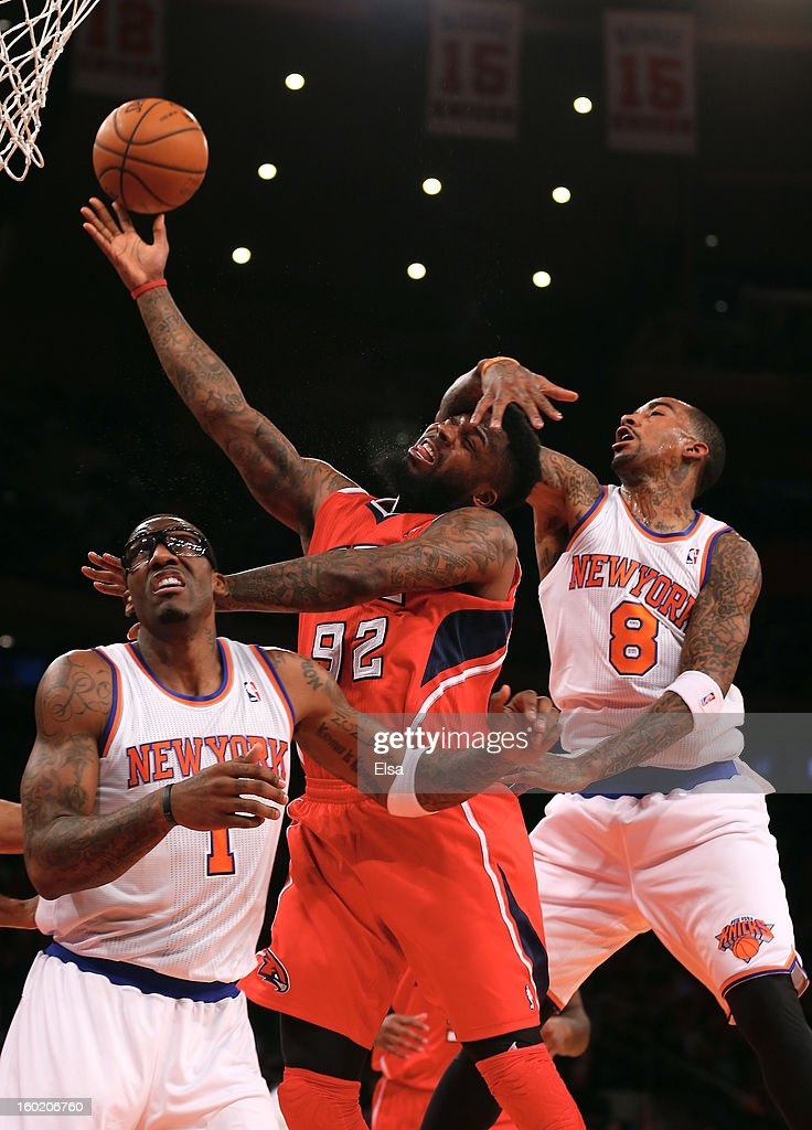 DeShawn Stevenson #92 of the Atlanta Hawks goes up for the basket as <a gi-track='captionPersonalityLinkClicked' href=/galleries/search?phrase=J.R.+Smith&family=editorial&specificpeople=201766 ng-click='$event.stopPropagation()'>J.R. Smith</a> #8 and Amar'e Stoudemire #1 of the New York Knicks defend on January 27, 2013 at Madison Square Garden in New York City.