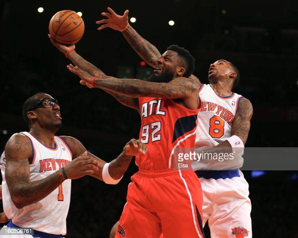 DeShawn Stevenson of the Atlanta Hawks goes up for the basket as JR Smith and Amar'e Stoudemire of the New York Knicks defend on January 27 2013 at...