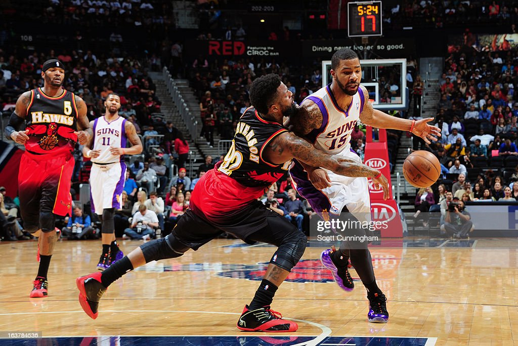 DeShawn Stevenson #92 of the Atlanta Hawks knocks the ball loose against Marcus Morris #15 of the Phoenix Suns on March 15, 2013 at Philips Arena in Atlanta, Georgia.