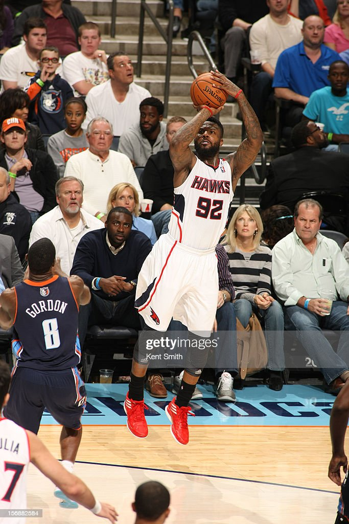 DeShawn Stevenson #92 of the Atlanta Hawks shoots against the Charlotte Bobcats at the Time Warner Cable Arena on November 23, 2012 in Charlotte, North Carolina.