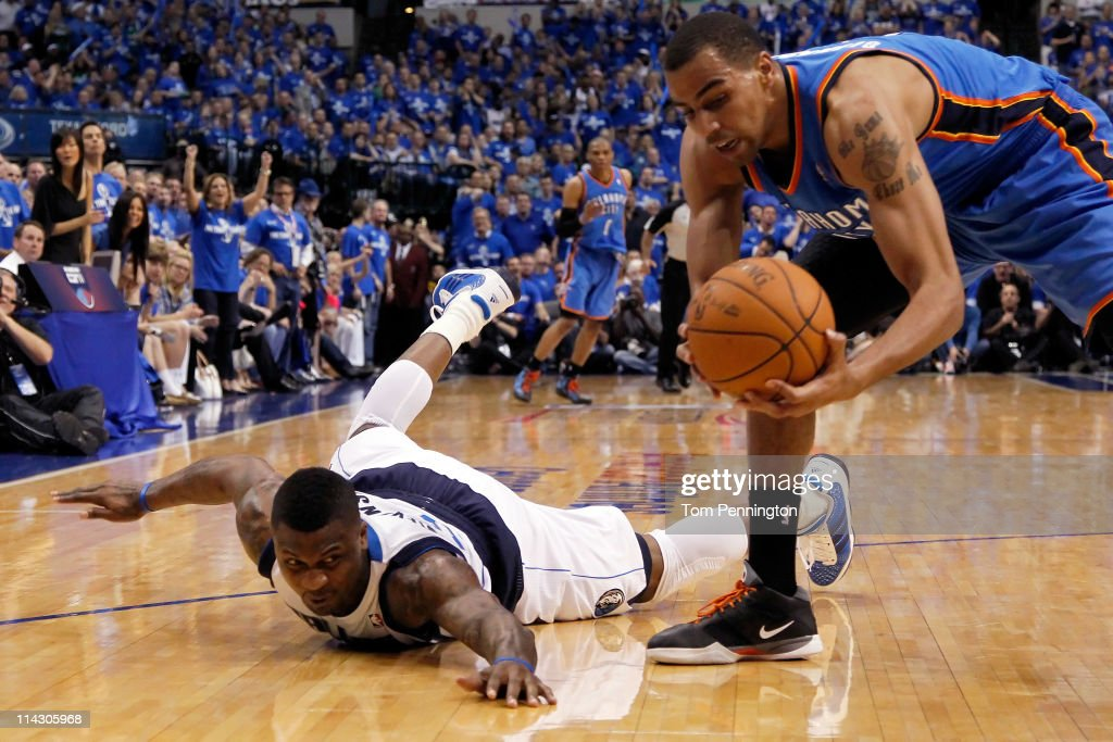 DeShawn Stevenson #92 of the Dallas Mavericks dives for the ball as Thabo Sefolosha #2 of the Oklahoma City Thunder grabs it in the third quarter in Game One of the Western Conference Finals during the 2011 NBA Playoffs at American Airlines Center on May 17, 2011 in Dallas, Texas.