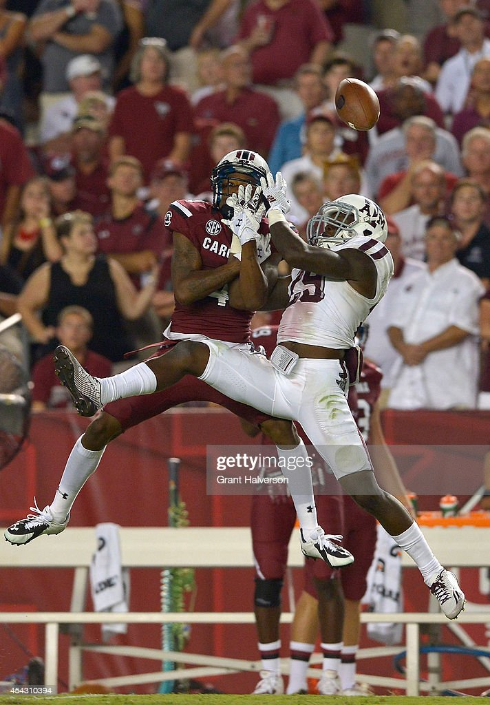 Deshazor Everett #29 of the Texas A&M Aggies breaks up a pass intended for Shaq Roland #4 of the South Carolina Gamecocks during their game at Williams-Brice Stadium on August 28, 2014 in Columbia, South Carolina. Texas A&M won 52-28.