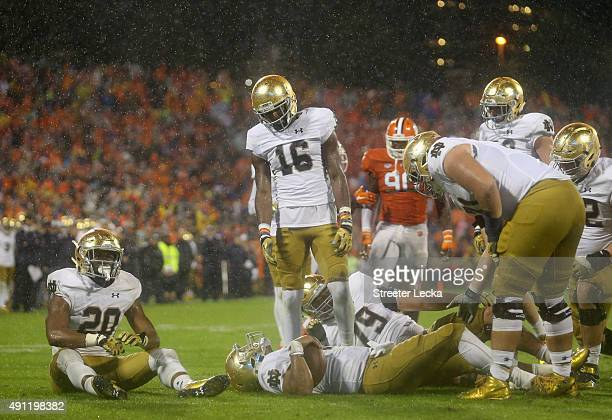 DeShone Kizer of the Notre Dame Fighting Irish and teammate CJ Prosise sit on the field after a goal line stop by the defense of the Clemson Tigers...