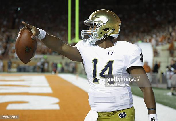 DeShone Kizer of the Notre Dame Fighting Irish celebrates scoring a 29yard rushing touchdown during the third quarter against the Texas Longhorns at...