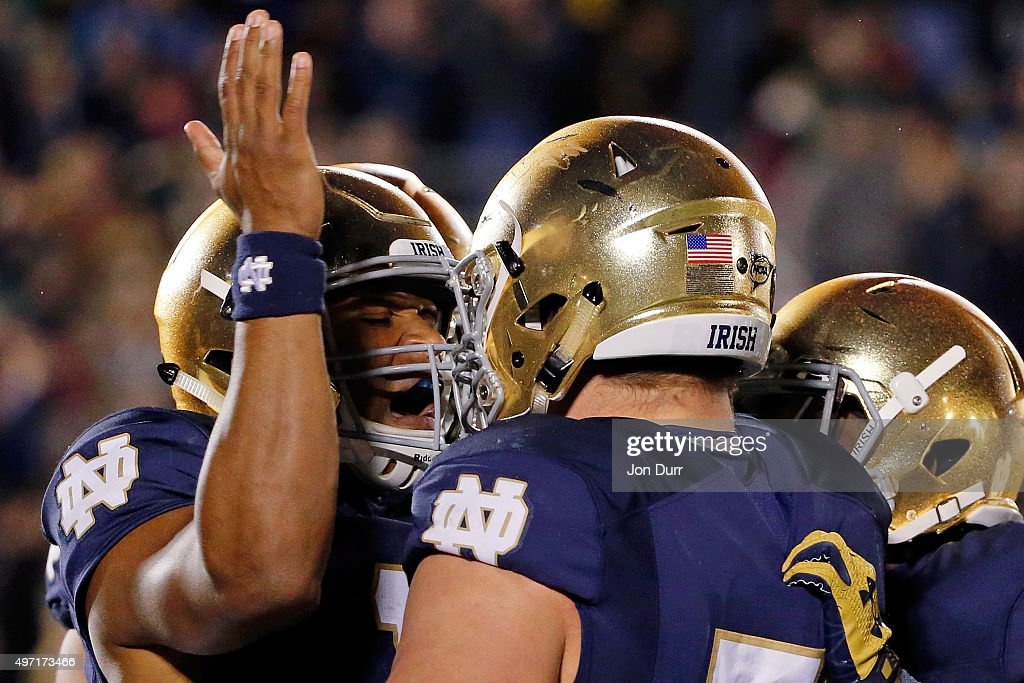 DeShone Kizer #14 of the Notre Dame Fighting Irish (L) celebrates with Nick Martin #72 (C) after scoring a touchdown against the Wake Forest Demon Deacons during the fourth quarter at Notre Dame Stadium on November 14, 2015 in South Bend, Indiana.The Notre Dame Fighting Irish won 28-7.