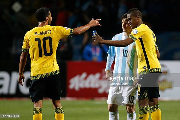 Deshorn Brown of Jamaica takes a selfie with Lionel Messi of Argentina during the 2015 Copa America Chile Group B match between Argentina and Jamaica...