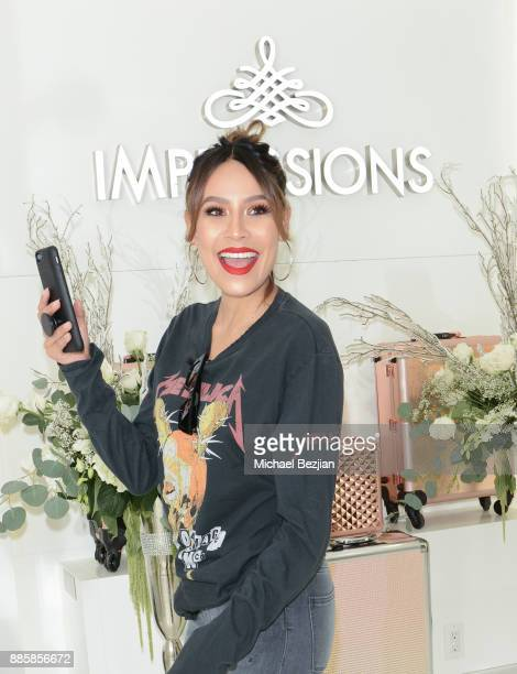 Desi Perkins attends Impressions Vanity Melrose Grand Opening Gala on December 4 2017 in Los Angeles California