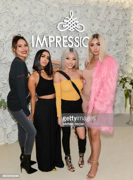 Desi Perkins Nida Isabel Bedoya and Melly Sanchez pose with fan at Impressions Vanity Melrose Grand Opening Gala on December 4 2017 in Los Angeles...