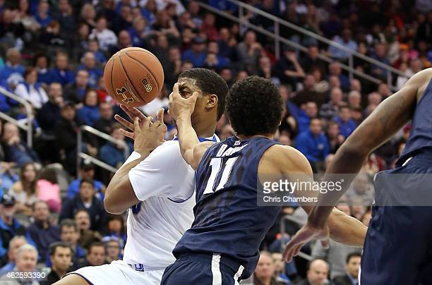 Desi Rodriguez of the Seton Hall Pirates draws contact as he drives to the basket against Dee Davis of the Xavier Musketeers during their Big East...