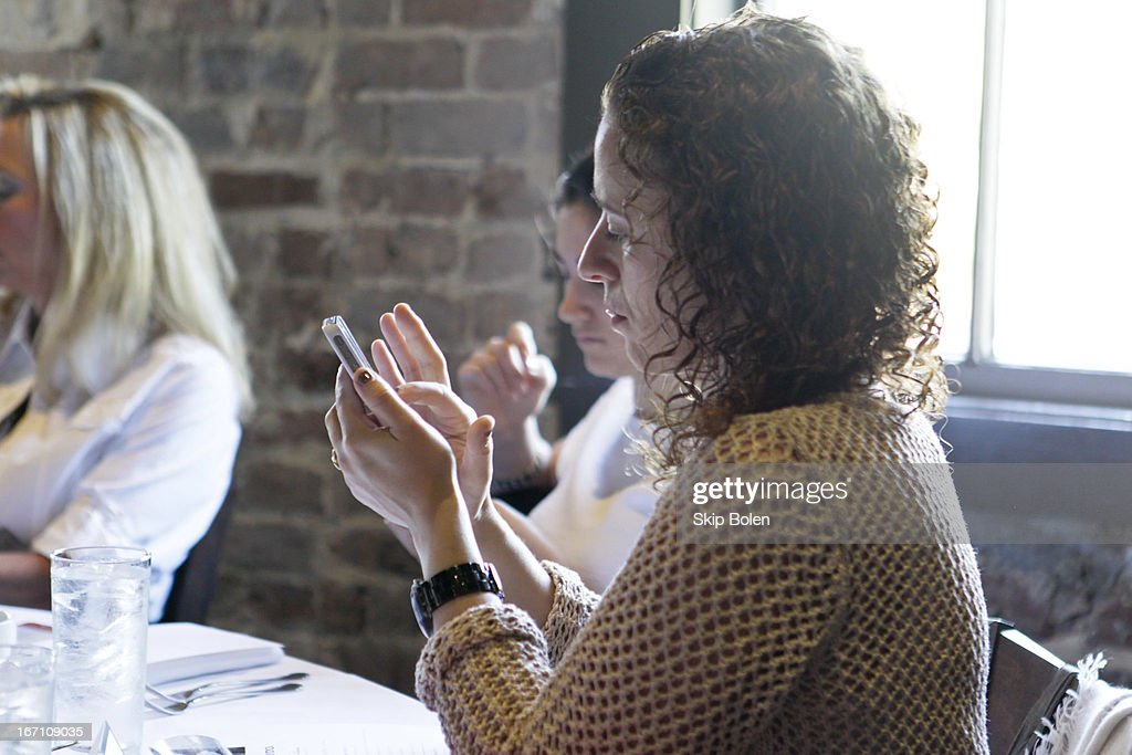 Design blogger takes notes during TOTO USA design blogger brunch. on April 20, 2013 in New Orleans, Louisiana.