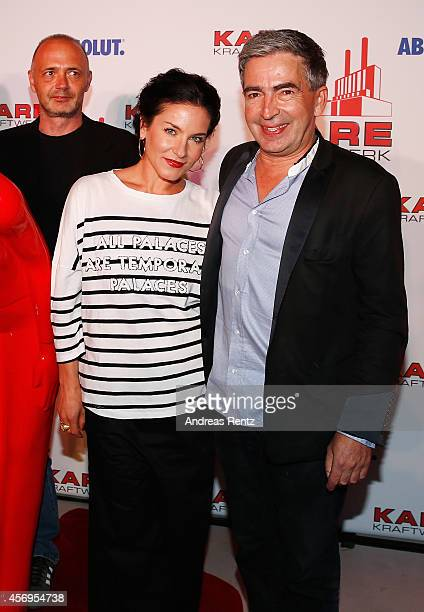 Design CEO Peter Schoenhofen and Marisa Burger attend the Grand opening of KARE Kraftwerk store on October 9 2014 in Munich Germany