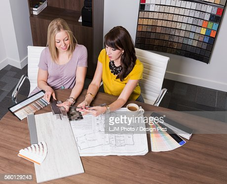 Design consultant and interior designer selecting paint for Interior design consultant