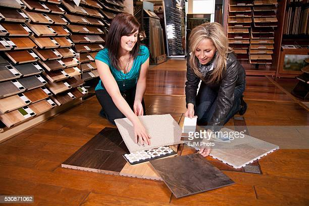 Design Consultant Assisting A Customer In A Retail Flooring Store; Edmonton, Alberta, Canada