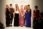 Design Contest finalists Hannah Soukup Will Riddle Morgan Selin Carly Rosenbrook Rachel Buske Sylvia Bukowski Bradley Mounce stand on the runway with...