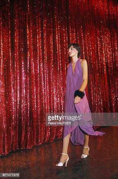 Design house Emmanuelle Khan shows its women's 1976 springsummer line in Paris Model Ines de la Fressange is wearing a loose purple dress