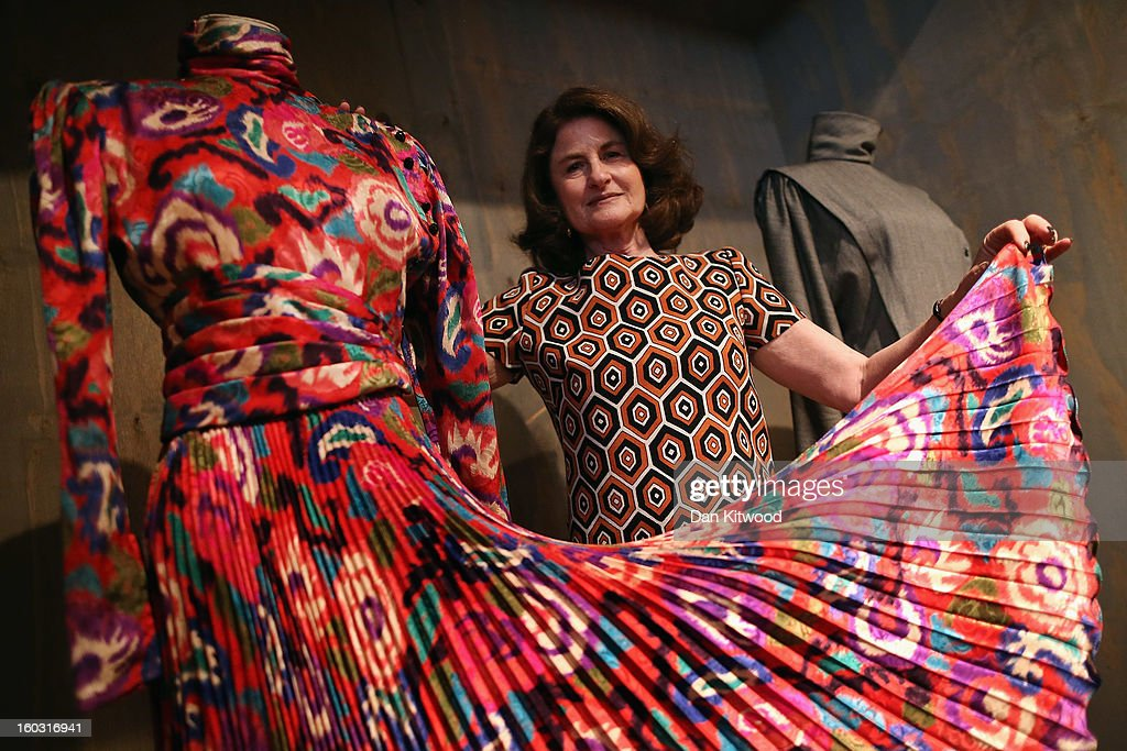 Design Museum trustee, Lady Jill Ritblat poses between two Emanuel Ungaro dresses during a photocall at The Design Museum on January 29, 2013 in London, England. The dresses make up a list of 400 fashion items donated to the museum by Lady Ritblat including dresses by Alexander McQueen and Chanel, and go on show in the Design Museum's permanent collection from today.