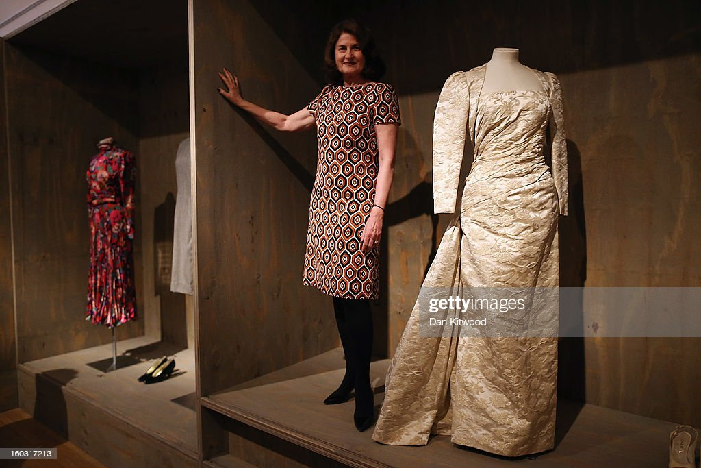 Design Museum trustee, Lady Jill Ritblat poses next to a Ball Gown designed by Victor Edelstein during a photocall at The Design Museum on January 29, 2013 in London, England. The piece makes up a list of 400 fashion items donated to the museum by Lady Ritblat including dresses by Alexander McQueen and Chanel, and go on show in the Design Museum's permanent collection from today.