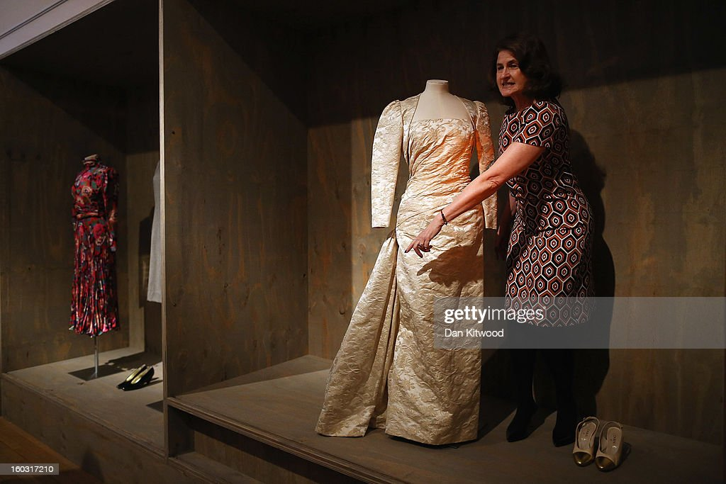 Design Museum trustee, Lady Jill Ritblat stands next to a Ball Gown designed by Victor Edelstein during a photocall at The Design Museum on January 29, 2013 in London, England. The piece makes up a list of 400 fashion items donated to the museum by Lady Ritblat including dresses by Alexander McQueen and Chanel, and go on show in the Design Museum's permanent collection from today.