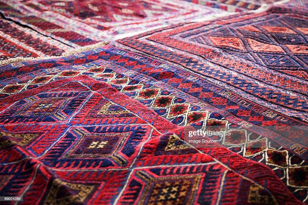 Design on rug in market : Stock Photo
