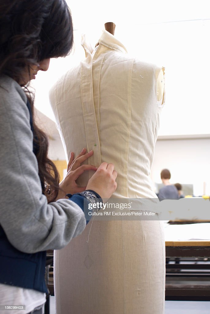 Design student fitting mannequin : Stock Photo